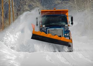 Plow Scooping Snow off the Road